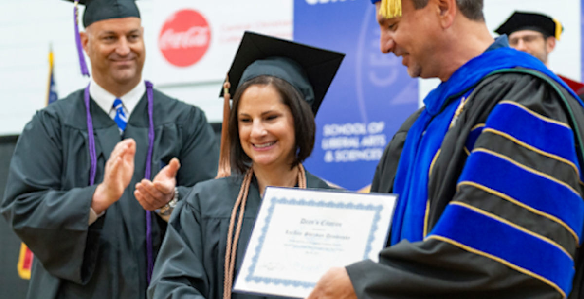 organizational leadership degree graduation: LeeAnn Sherman walking in May 2019 Graduation Ceremony on Campus at Central Christian College of Kansas. Photo by Aaron Lindberg Photography.