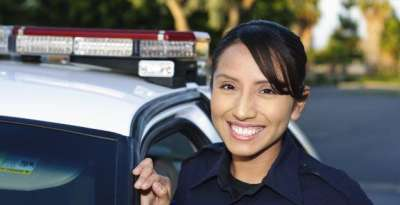 Policewoman standing next to prowler